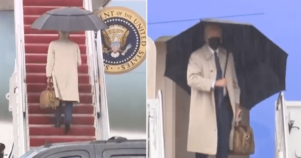 WATCH: Biden boards Air Force One while holding bag and umbrella
